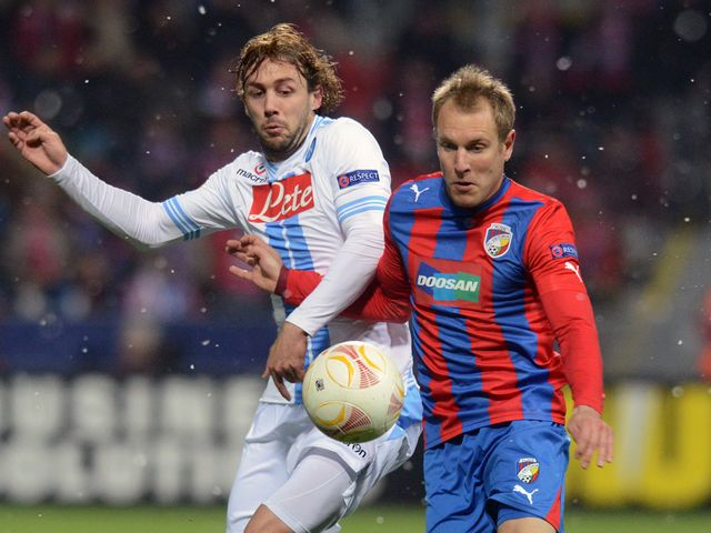 Napoli's Marco Donadel and Daniel Kolar battle for possession