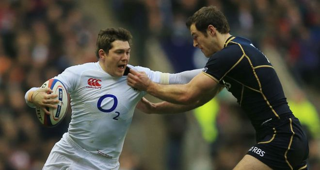 England's Alex Goode hands off Scotland wing Tim Visser