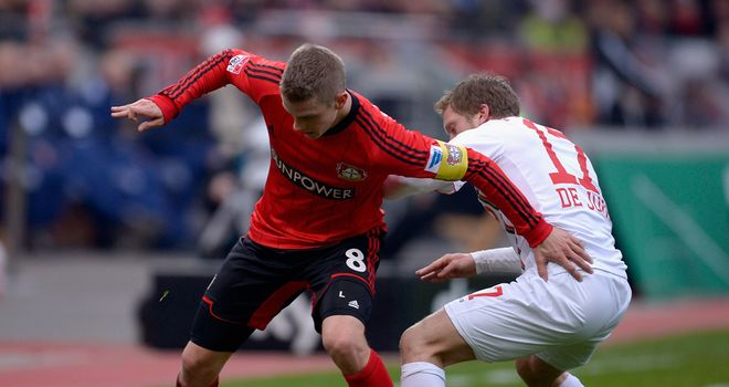 Lars Bender and Marcel de Jong battle for possession