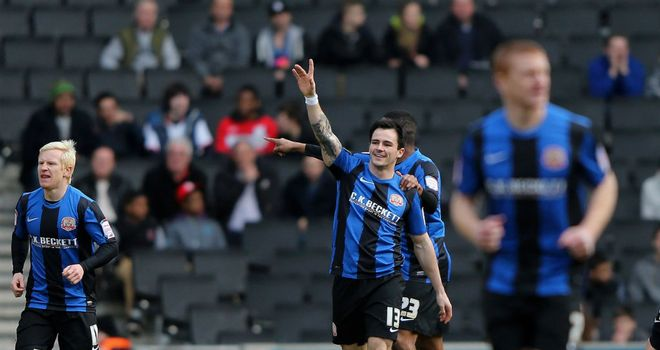 Chris Dagnall: Celebrates after opening the scoring for Barnsley at MK Dons