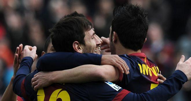 Lionel Messi celebrates his latest Barcelona goal