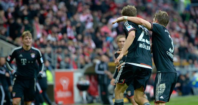 Thomas Mueller celebrates putting Bayern in front