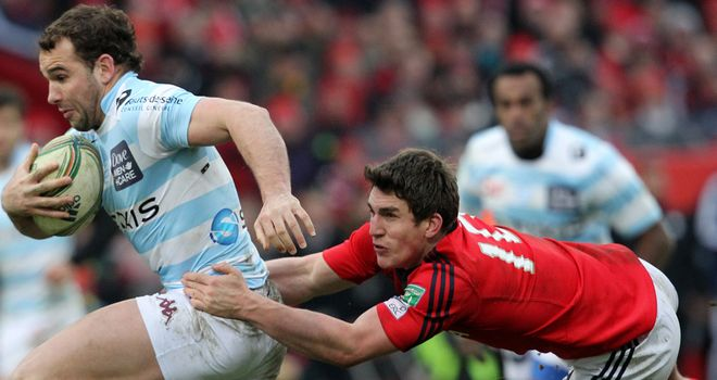 Ian Keatley tackles Olly Barkley during Munster's bonus-point win over Racing Metro last month