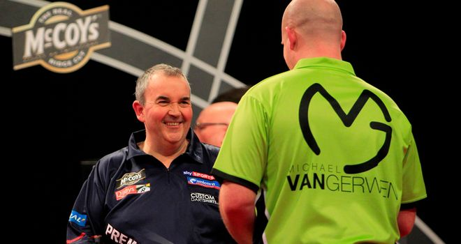 Michael van Gerwen and Phil Taylor: had to settle for a point apiece in the final match of the night