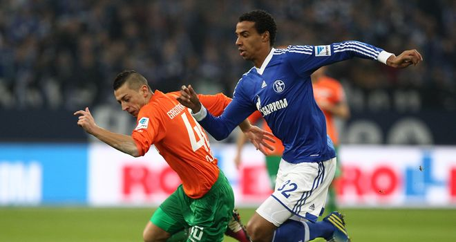 Nikola Djurdjic gives chase with Joel Matip