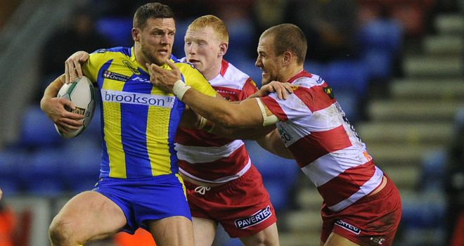 Warrington's Simon Grix: Tackled by Liam Farrell and Lee Mossop