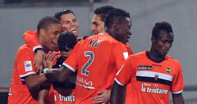 Lorient celebrate Kevin Monnet-Paquet's winning goal