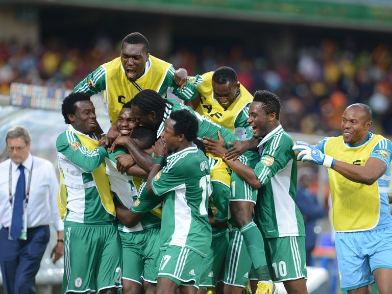 Emmanuel Emenike's goal finds him mobbed by his team-mates