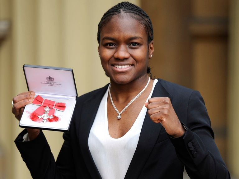 Nicola Adams shows off her MBE