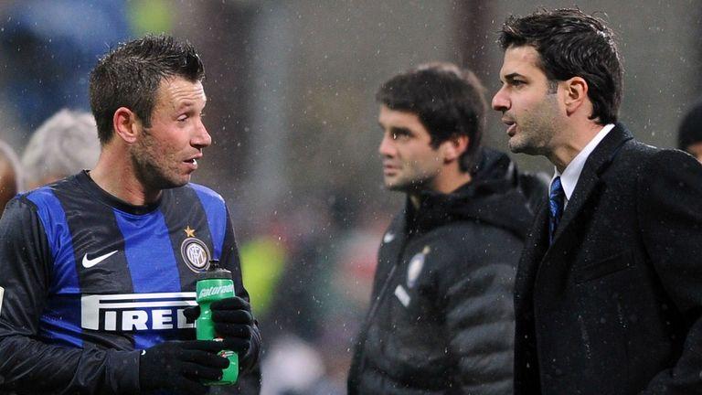 Andrea Stramaccioni, right, has played down his 'discussion' with Antonio Cassano, left