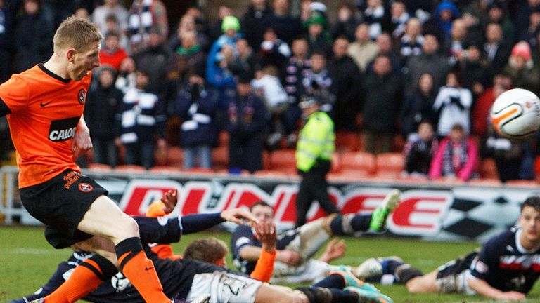 Michael Gardyne nets his goal in the Dundee derby