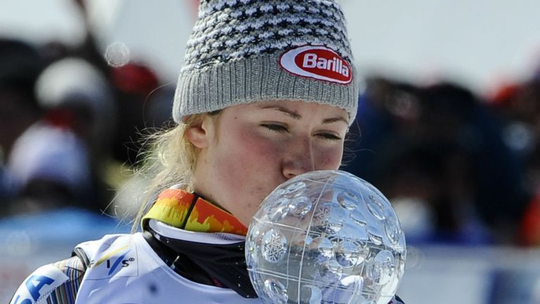 Mikaela Shiffrin: American teenager kisses the crystal globe after her slalom victory