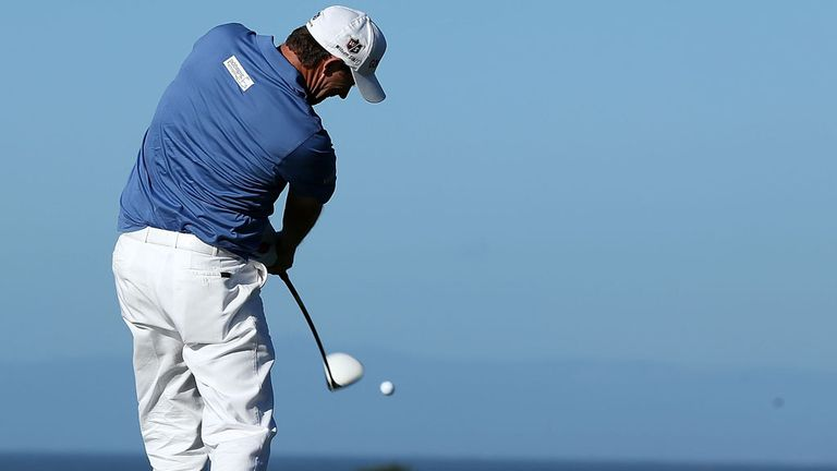 Padraig Harrington - pictured here at Pebble Beach - is two off the pace in Thailand