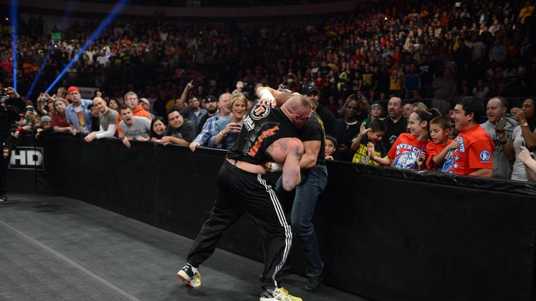Best of enemies: Lesnar (L) and Triple H will go to war again at WrestleMania