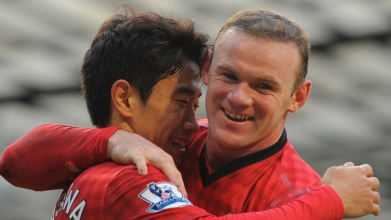 Shinji Kagawa and Wayne Rooney embrace after helping United to a 15-point lead at the Premier League summit