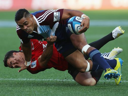 Francis Saili of the Blues fends off Dan Carter
