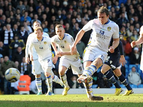Leeds' Stephen Warnock slots home from the spot