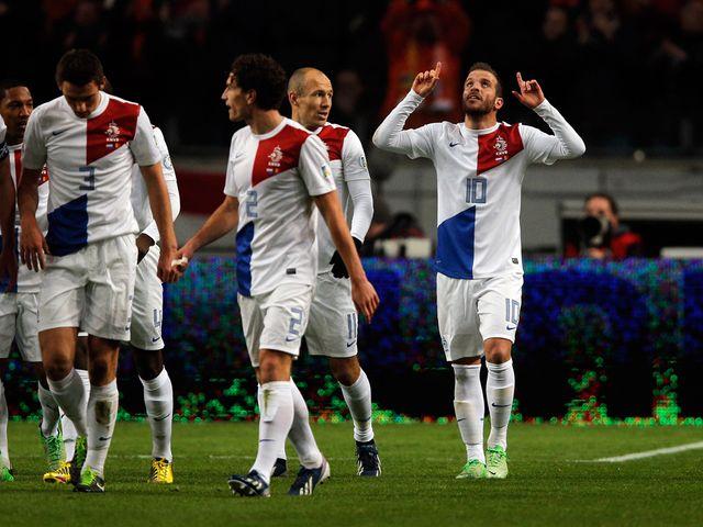 Holland celebrate Rafael Van der Vaart's goal