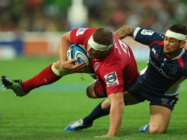 James Slipper of the Reds is tackled