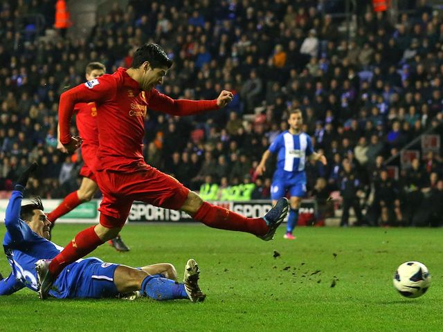 Suarez scores to complete his hat-trick