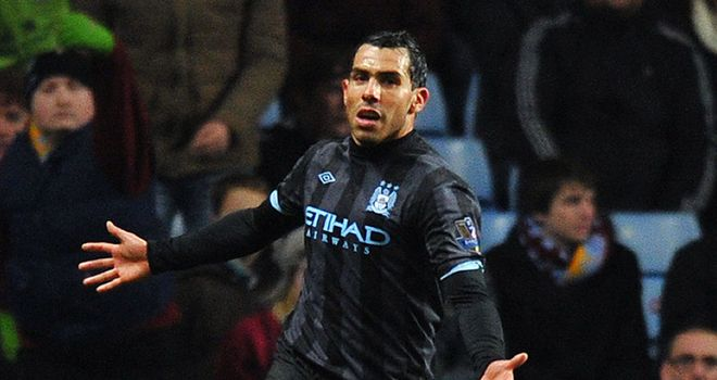 Carlos Tevez: Manchester City striker has been urged to carry on scoring by Roberto Mancini