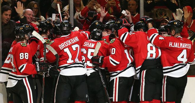 Chicago Blackhawks celebrate their overtime victory