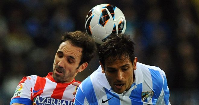 Juanfran and Roque Santa Cruz in aerial battle