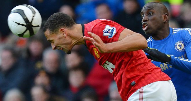 Rio Ferdinand beats Demba Ba to a header during Sunday's FA Cup quarter-final