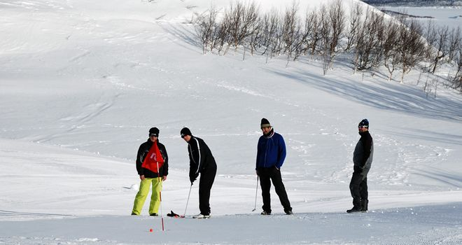 Snow golf in Swedish Lapland