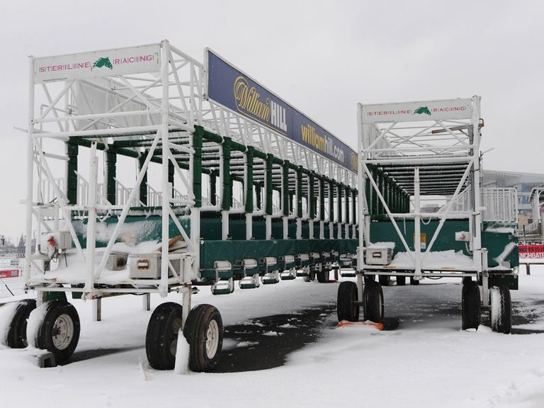 The starting stalls at Doncaster lie covered in snow on Saturday morning