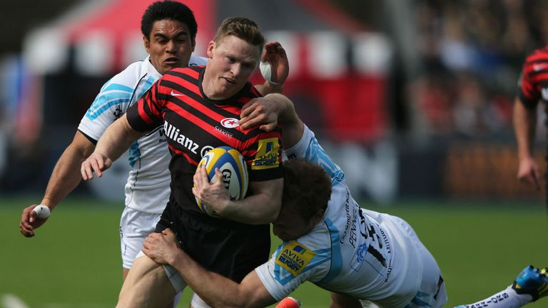 Chris Ashton of Saracens is tackled by Chris Pennel