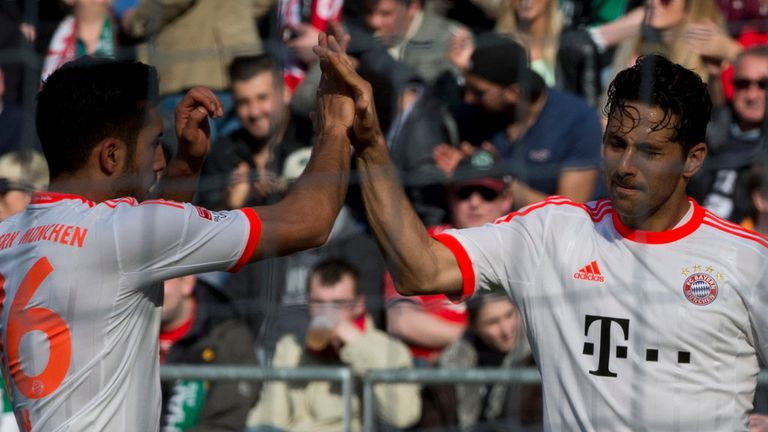 Claudio Pizarro (right): Celebrates goal in Bayern's win over Hannover