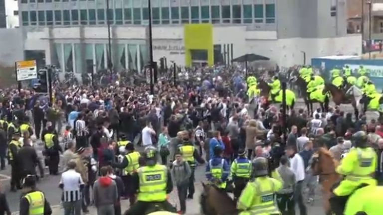 Violence: Scenes from outside St James' Park after the match