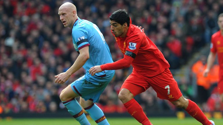 James Collins sticks close to Luis Suarez during Sunday's goalless draw