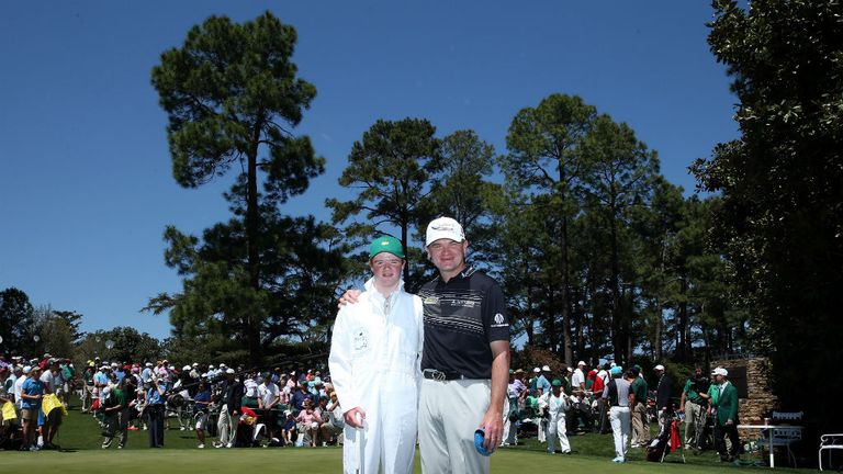 Paul Lawrie: Poses with son Michael during the Par-3 Contest at Augusta on Wednesday