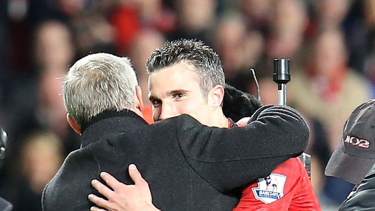 Sir Alex Ferguson and Robin van Persie share an embrace