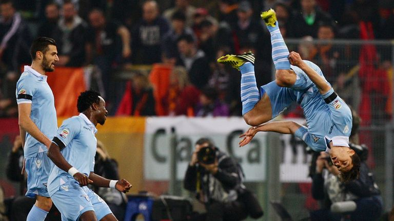 Hernanes celebrates after giving Lazio the lead