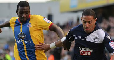 Yannick Bolasie and Liam Feeney: Battle for the ball at The Den