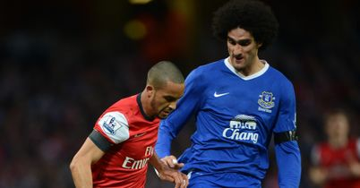 Marouane Fellaini: Challenges Theo Walcott at Emirates Stadium