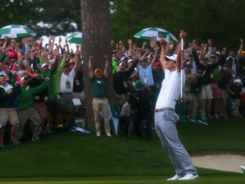 Adam Scott celebrates after sinking the winning putt