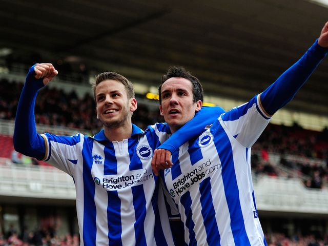Andrea Orlandi and David Lopez celebrate for Brighton