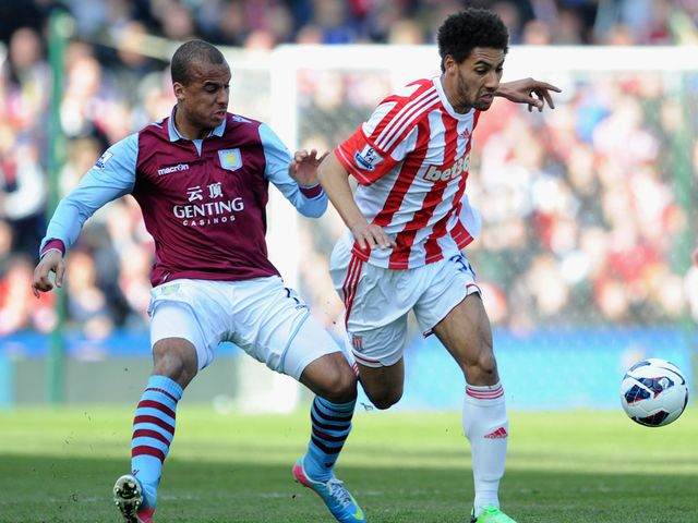 Gabriel Agbonlahor and Ryan Shotton battle for the ball