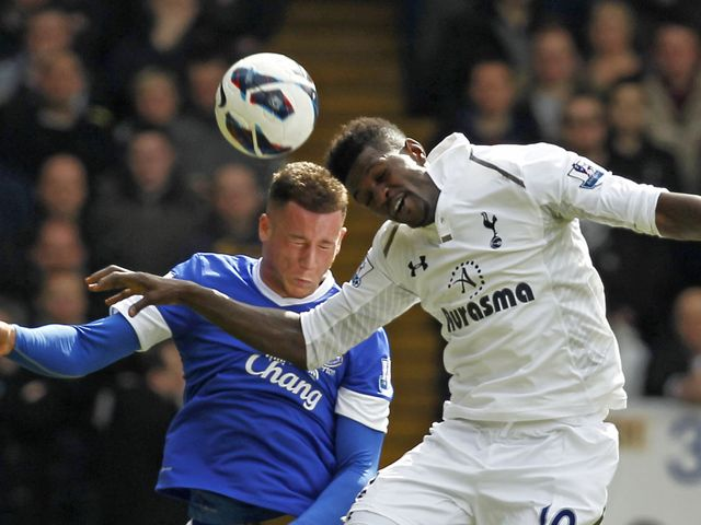 Ross Barkley and Emmanuel Adebayor go for a header