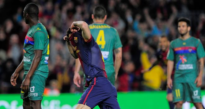 Cesc Fabregas celebrates his late goal at the Nou Camp