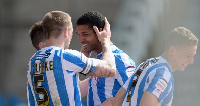 Jermaine Beckford: Celebrates his opener for Huddersfield with Peter Clarke