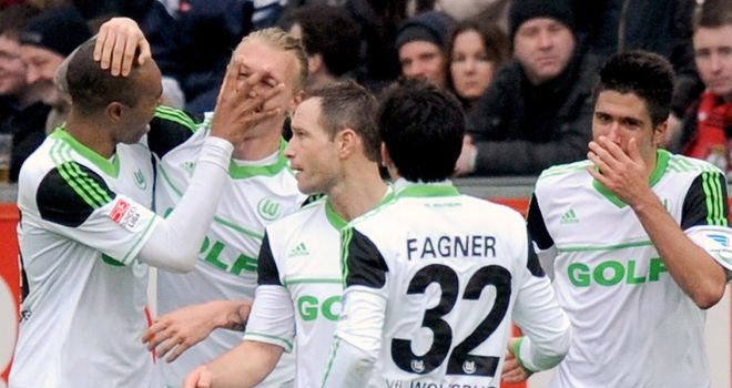 Simon Kjaer is mobbed following Wolfsburg's equaliser