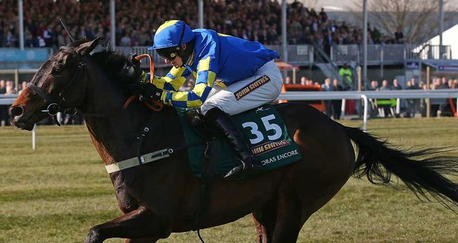 Auroras Encore gallops to victory in the Grand National at Aintree