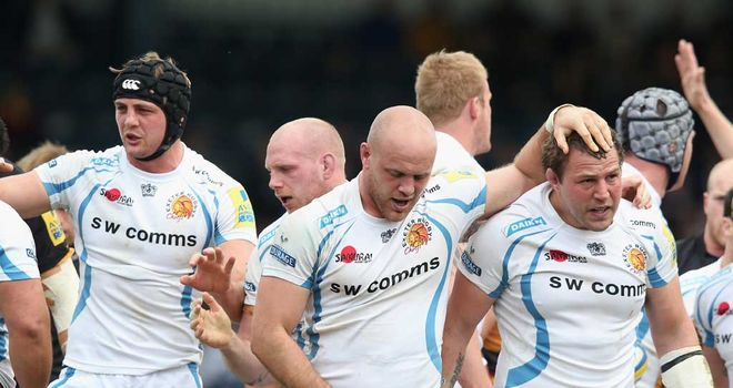 Exeter players celebrate scoring a try at Wasps