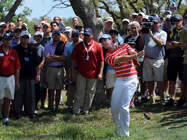 McIlroy: Four shots back