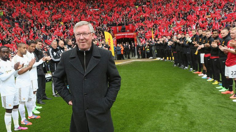 End of an era: Sir Alex Ferguson walks out to a guard of honour for his final game at Old Trafford